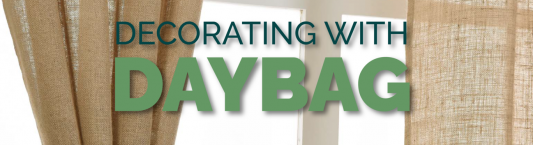 """Window and curtain with logo and text saying """"Decordating with Daybag"""""""
